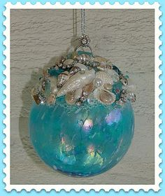 Aqua glass and seashell ornament. I can think of some changes that would work awesome! Coastal Christmas Decor, Nautical Christmas, Tropical Christmas, Handmade Christmas, Beach Christmas Trees, Seashell Projects, Seashell Crafts, Seashell Art, Sea Glass Crafts