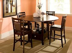 Raymour & Flanigan -- purchased this kitchen table and love it! It has a built in 'lazy susan' and great storage.