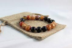 Charles  $60.00 CAD  12 mm laser cute Agate Beads  Handmade with strong stretch cord