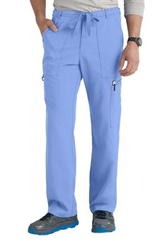 FIT THAT GOES THE DISTANCESix pockets will see you through your shift with no worries, but who's counting when you're cool and comfortable in these easy-care scrub pants?  You'll appreciate the extra details such as interior pockets and an I.D. tab when you choose the Grey's Anatomy 6-Pocket Men's Drawstring Waist Scrub pants.   Grey's Anatomy Men's 6 Pocket Drawstring Waist Scrub Pants  Zip fly  Straight, relaxed leg  Six pockets, including two front pockets, a co...