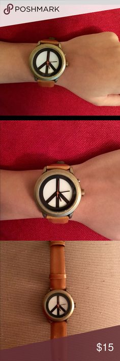 Lucky Brand Peace Sign Watch Lucky Brand Stainless Steel Back Peace Sign Watch. Needs new battery. Leather strap is worn, but still looks good for a vintage look. Part of strap is coming apart, as shown in pictures, but still wearable and not noticeable. Lucky Brand Accessories Watches
