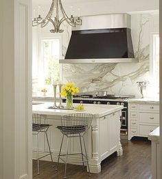 Carrara Marble will look the best with a plain white like BM OC-65 Chantilly Lace or Behr Snow Fall WF600 (below) or even a white with a blue undertone like Behr 790C-1 or Dulux White Wing 50GY 83/010.