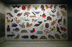 Space For All Species Mural, USA by Charley Harper 1964     Charley Harper's first ever mural 'Space For All Species' is located in the John Weld Peck Federal Building at 550 Main St. in downtown Cincinnati. Completed in 1964 the design is comprised of two 18×10½ ft panels that feature over 100 species of North American Animals. The tiles were made by Cambridge Tile Company in Cincinnati, OH.