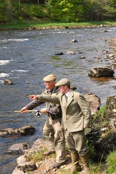 Well these have got to be the most well dressed fishermen ever. Classic fly fishing in the UK...