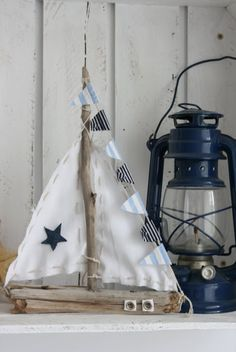sweet shabby little driftwood sailboat w/bunting