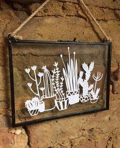 Cactus paper cut design in glass hanging frame. £15.00