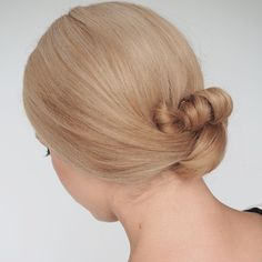 I love how minimalist this style is and it's so simple to do. Search 'double knot bun' on www.hairromance.com to find my tutorial