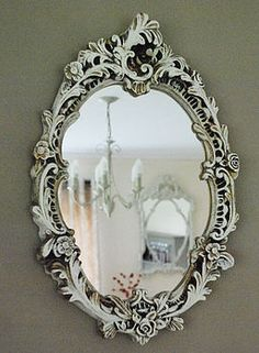 I've bought TWO rococo mirrors from Goodwill that I plan to paint in bold colors and hang in the bathrooms. Z