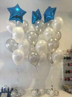 Feature sapphire blue star foil balloon with white and (leaving out the silver and adding blue = school colors) latex below.