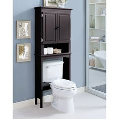 The elegant Wakefield Over the Toilet Space Saver features 2 tall cabinets and a shelf for all of your bathroom essentials. The cabinets can discreetly hold anything from towels to personal items, and the space saver fits neatly over a toilet. Behind Toilet Storage, Over Toilet Storage Cabinet, Pantry Cabinet Free Standing, Bathroom Cabinets Over Toilet, Dark Wood Bathroom, Shelves Over Toilet, Storage Cabinets, Bathroom Storage, Bathroom Ideas