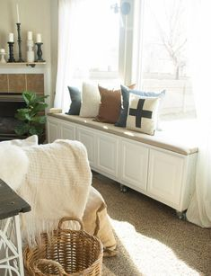 10 Ways to Fake a Window Seat Even as a Renter: standard cabinets on casters for flexible seating & storage  #diy; #apartment; #windowseat