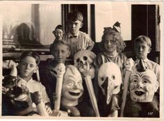Anonymous Works: Circa 1920's Photo of Children with Masks. Look at the kid in the back
