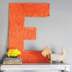 Giant Fringe Monogram: This might look like a piñata, but it only takes a fraction of the time to make since you only have to cover one dimension in fringe.
