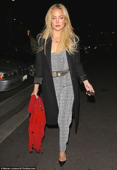 Chic:The mother-of-two dressed layered on a long black menswear-inspired jacket, dressing...