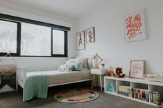 Chifley house in Canberra, Australia designed by Studio Black Interiors.  Girl's bedroom.  For a little girl that doesn't like pink - a palette of soft pale green and a hint of copper.