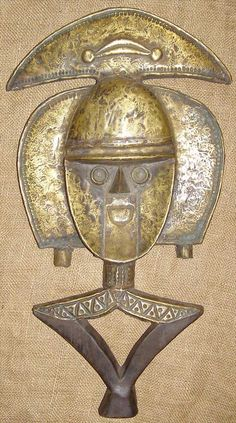 African Statues - Bakota Reliquary Guardian . Made of hand hammered bronze. Love it.