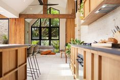 An industrial style coastal home with gorgeous timber and warm tones in Byron Bay Timber Cladding, Exterior Cladding, Shelley Craft, Byron Bay Beach, Raked Ceiling, Internal Courtyard, Timber Door, Concrete Kitchen, Contemporary Kitchen Design