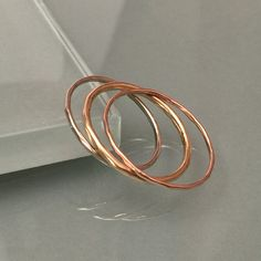 14K Ring Thin Band Stacking Rings by EllynBlueJewelry on Etsy https://www.etsy.com/listing/219579488/14k-ring-thin-band-stacking-rings