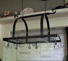 black hanging pan rack kitchen metal