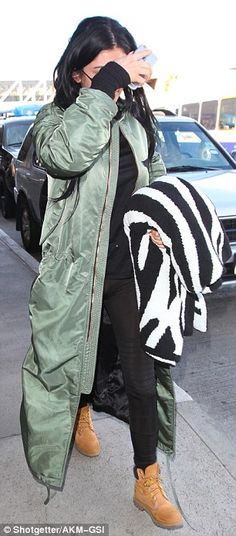 Explosive look:With an oversized green bomber jacket proving to be the focal point, Kylie was in a typically low-key mood while scurrying through the entrance, one hand shielding her face