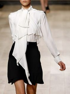 white blouse; I'd wear this with narrow trousers
