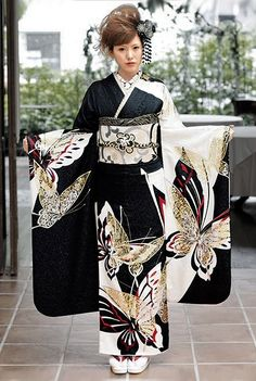 Modeling a contemporary furisode.  Japan.  Image via Pinterest