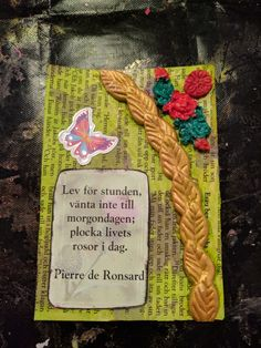 "The first card in a new series called ""Kloka Ord"" which is swedish for wise words.   Made February 24th and it's a quote from Pierre de Ronsard, I don't know the exact quote but the translation on the card says ""live for the moment, don't wait for tomorrow, pluck the roses of life today"""