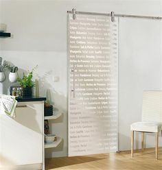 glass door with words on. Could be quotes from famous literature, or words related to the fun of reading.