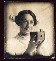 Bright eyed girl showing off her new camera.  This isn't a true photo booth shot since they weren't reliably used by the public until 1925.  It's more likely to be a Victorian Gem photo, but it's still adorably sweet and small.