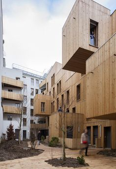 https://i0.wp.com/static3.businessinsider.com/image/52e2a85b69bedd702ff141ca-1200/best-housing-tete-in-lair-a-wooden-apartment-building-north-of-paris-france.jpg