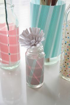 Love how the colorful patterned tape dress up ordinary glass bottles, gotta get some!