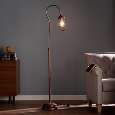 Light up just the right spot in your living space with the Southern Enterprises Terrance Floor Lamp . This industrial-inspired floor lamp features a. Industrial Floor Lamps, Industrial Chic, Industrial Revolution, Bronze Floor Lamp, Contemporary Floor Lamps, Modern Contemporary, Lamp Shade Store, Street Lamp, Pipe Lamp