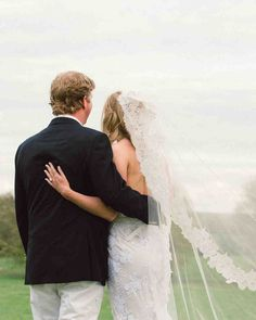 A Country-Chic Wedding on a New Jersey Farm | Martha Stewart Weddings -  The bride paired the mermaid-style Mira Zwillinger wedding dress with simple, nude Stuart Weitzman sandals and her mother's long, lace-trimmed veil from the 1970s.