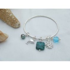 Beautiful, Handmade sterling silver bangle with fine silver charms and beads in a seashore theme. Made in UK. http://www.madecloser.co.uk/jewellery-watches/womens-jewellery/seashore-bangle-dolphin-coral