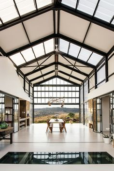 Open air dining area features polished concrete floors and high vaulted ceilings in this home outside of Pretoria, South Africa. Design Jobs, Layout Design, Design Ideas, Conservatory House, Architecture Design, Building Architecture, Residential Architecture, Casas Containers, Small Barns