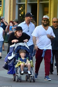 Family day out:Adele has proved she is still the same down-to-earth girl she always was as she ambled around Disneyland in Anaheim, California on Friday with her partner Simon Konecki and son Angelo