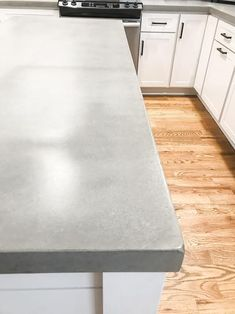 There are several ways you can make concrete countertops and several recipes for the concrete out there. My husband did a lot of research and decided on this pa… Making Concrete Countertops, Painting Laminate Countertops, Formica Countertops, Porcelain Countertops, Modern Countertops, Diy Kitchen, Kitchen Decor, Kitchen Cabinets, Kitchen Ideas