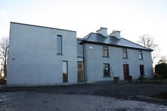 Daytime shot from front (north) on this contemporary extension to traditional 2 storey Irish farmhouse