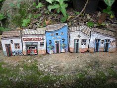 bricks or rocks painted like mini buildings