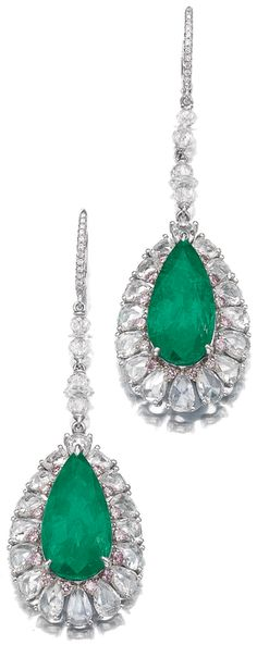 Pair of emerald, pink-tinted diamond,and diamond pendent earrings. Each set with a pear-shaped emerald weighing 8.47 and 8.91 carats, within a border of brilliant-cut diamonds of pink tint, further set with pear-shaped, rose, briolette and diamond rondelles, post fittings. Via Sotheby's.