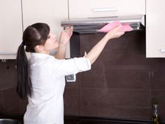 The combination of  cooking grease, steam, and regular old dust creates a sticky residue on your kitchen's surfaces. Clean up grease splatters from your walls, range hood, and  cabinets by washing them with a sponge dipped in undiluted white vinegar. Use  another sponge soaked in water to rinse, then wipe dry with paper towels. Tip: Don't forget the top of your fridge, which can get greasy as well. Source: Woman's Day