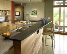Bamboo cabinetry with paperstone breakfast bar