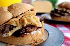 "Smoked Barbecue Beef Brisket Sandwiches. These ""smoked"" barbecue beef brisket sandwiches are actually made in the slow cooker. Fork-tender, they are delicious topped with barbecue sauce, mayo, smoked Gouda cheese and crispy onion straws. My husband declared them one of the best sandwiches ever."