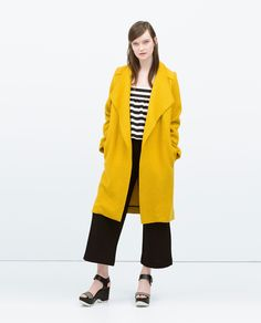 Rock a mustard coat with black culottes to effortlessly deal with whatever this day throws at you. Why not add black and white horizontal striped leather wedge sandals to the mix for a more relaxed feel?   Shop this look on Lookastic: https://lookastic.com/women/looks/mustard-coat-white-and-black-cropped-top-black-culottes/14823   — White and Black Horizontal Striped Cropped Top  — Mustard Coat  — Black Culottes  — Black and White Horizontal Striped Leather Wedge Sandals