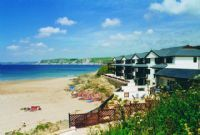 Right on the beach, the managing agent has 3 x apartments we could rent, all the same block.  Indoor pool, games room, no where near Lyme Regis but could be great option!