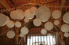 Oakwood Events showcasing our white and lace lanterns at a wedding fair.