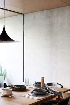 Minimal dining area with black pendent light and dark ceramics Dining Set, Kitchen Dining, Diy Home Decor, Room Decor, Interior Architecture, Interior Design, Dining Room Inspiration, Küchen Design, Design Styles