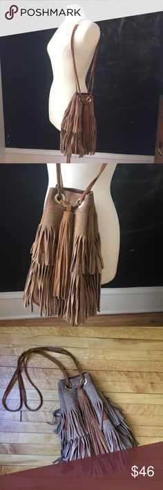 ZARA Leather Fringed Drawstring Purse! 🌞 This gorgeous, fringed shoulder bag/purse is from Zara. It's in a caramel colored brown suede. It has been well loved and there is discoloring and scuffing, dark marks on the bottom (as seen in last photo) and a general broken in, worn appearance. Could possibly be professionally cleaned or, if you're like me, enjoyed as it appears - like a vintage piece! There are Gold grommets and several interior pockets.   I will review all offers and answer any…