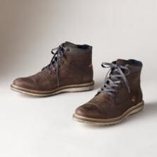 A pair of supremely comfortable suede and leather low boots with charmingly laid-back touches.