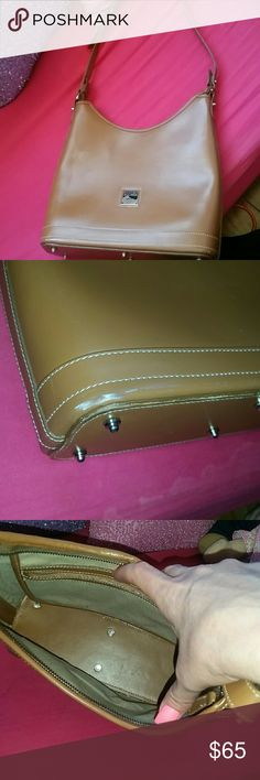 Dooney Bourke Purse Very well made leather purse. There is a suff on one of the corners of the bag. Other than that scuff, it is in excellent condition.  Used a handful of times. Very classic style. Dooney & Bourke Bags Shoulder Bags
